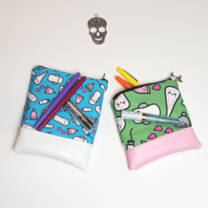 Small and medium pouches with pens and lipstick to demonstrate size