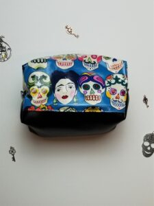 Side view of the boxy zipper pouch